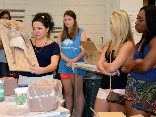 stacey johnson explains her method of creating sculptures to jcjc students a.jpg