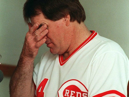 Cincinnati Reds manager Pete Rose rubs his eyes June 26, 1989 at the start of his regularly scheduled post-game press conference at Riverfront Stadium.