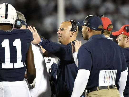 James Franklin, center, has had to replace three assistants this offseason, including receivers' coach Josh Gattis, right. His latest hire, Ja'Juan Seider, holds strong recruiting ties to Florida.