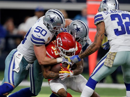 Dallas Cowboys linebacker Sean Lee (50) could be getting some help at the position in the first round of the NFL Draft Thursday.