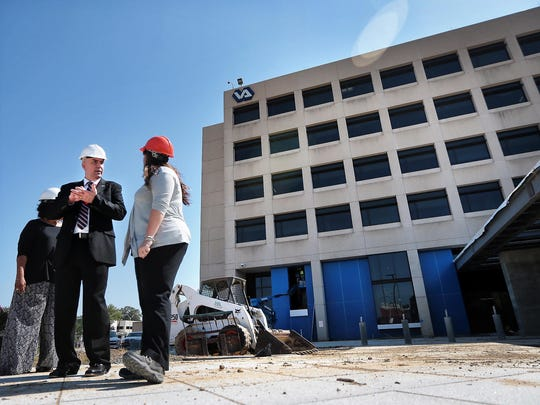 Memphis Veterans Affairs Medical Center Director David Dunning, left, talks with the VA's chief engineer as work continues on a new front entrance to the hospital.