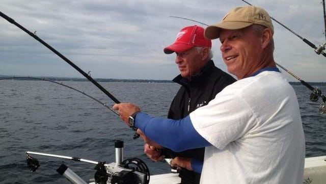 Gordie Howe and son Mark go on a fishing trip.