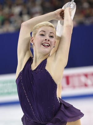 Gracie Gold of the U.S. performs during the women's free skating program of the figure skating world championships.
