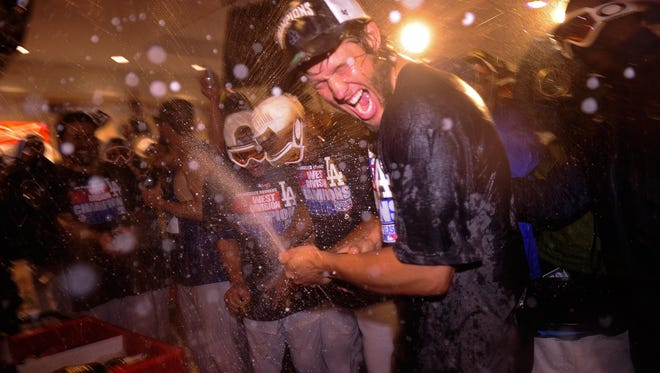 Dodgers starting pitcher Clayton Kershaw gets a champagne shower.
