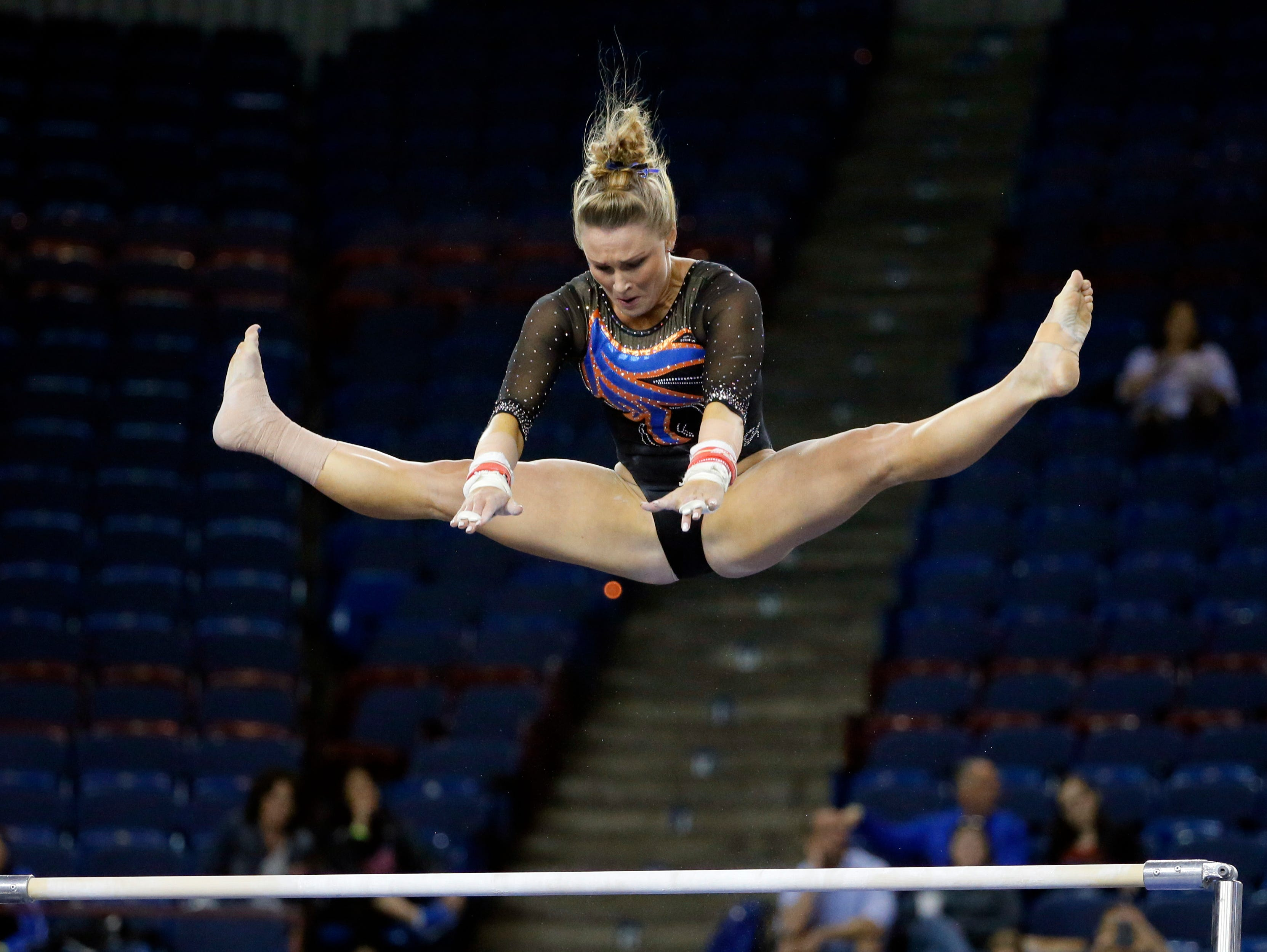 Florida's Bridget Sloan competes on the uneven parallel bars during the NCAA women's gymnastics championships Friday, April 15, 2016, in Fort Worth, Texas.