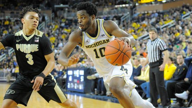 Michigan's Derrick Walton Jr. drives against Purdue's Carsen Edwards in the second half.