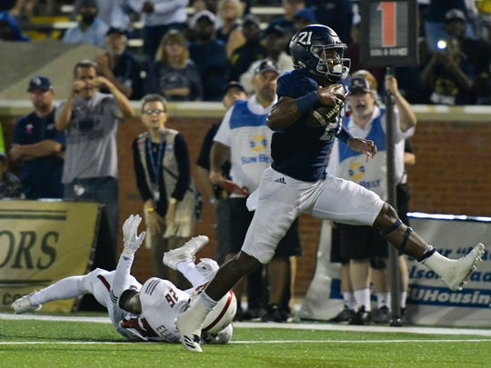Georgia Southern running back Wesley Fields slips an attempted tackle by Arkansas State linebacker Trent Ellis-Brewer and steps into the end zone on an 8-yard touchdown run during the second quarter of an NCAA college football game at Paulson Stadium in Statesboro, Ga., Wednesday, Oct. 4, 2017. (Scott Bryant/The Statesboro Herald via AP)