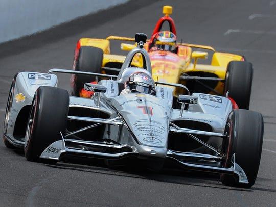 Team Penske IndyCar driver Josef Newgarden (1) rounds