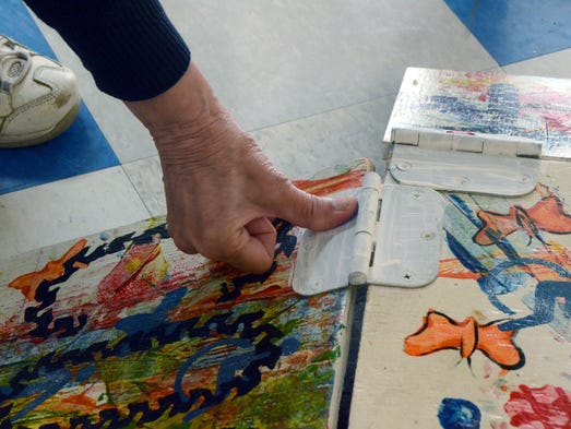 """The artists of """"Accessible Dreams"""" signed the artwork"""