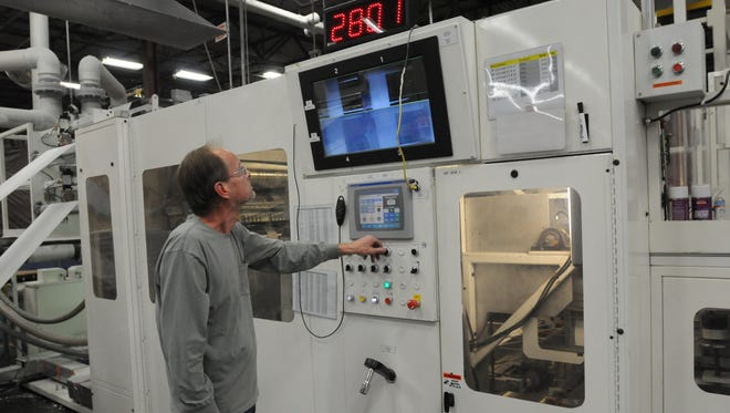 Brian Radke, specialty operator with Hoffmaster Group Inc., operates a highly computerized and automated napkin folder and cutter machine at Hoffmaster in Oshkosh.  Hoffmaster Group Inc. provides disposable table paper products for the home, restaurants and industry.
