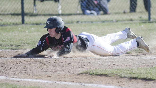 Hunter Marso of Brandon Valley dives into home plate Thursday, April 26, in Game 1 of a doubleheader against Sioux Falls Lincoln at Valley Springs.
