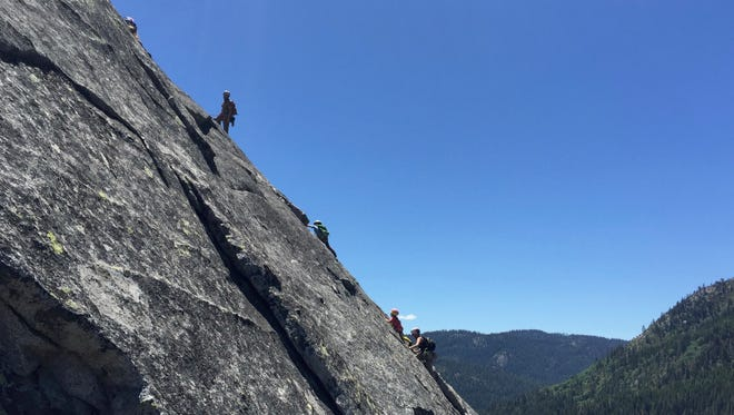 The Miller family, including kids Jane and Michael, climb   the Manic Depressive Direct route on Hogsback at Lover's Leap west of South Lake Tahoe.
