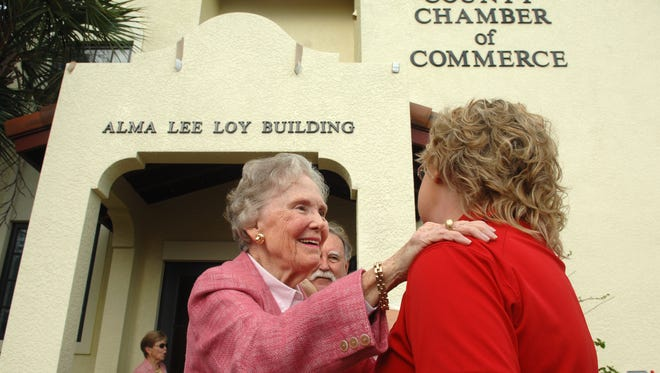 Alma Lee Loy (left) talks with Vero Beach High School band president Debbie Robinson in November 2010 following the naming ceremony distinguishing the Indian River Chamber of Commerce building as the Alma Lee Loy Building in downtown Vero Beach. On Wednesday night, the Chamber honored several local companies and business owners during a ceremony at the Vero Beach Country Club.
