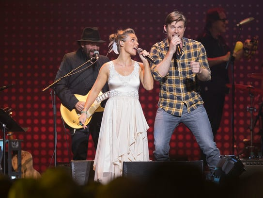 Clare Bowen and Chris Carmack perform on the 'Nashville'