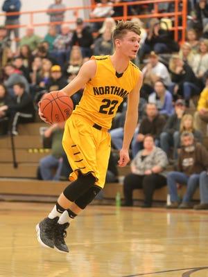 Northmor's Brock Pletcher dribbles the ball at Lucas High School on Tuesday evening.