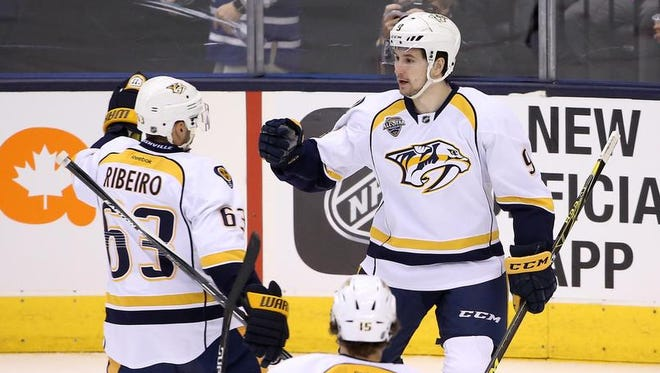 Predators left wing Filip Forsberg (9) celebrates his goal in the first period with center Mike Ribeiro (63) against the Maple Leafs at Air Canada Centre.