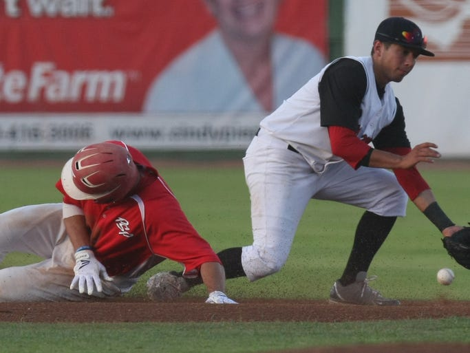 Palm Springs runner Ryne Clark dislodges the second base bag during a slide as the ball gets past an Inland Valley infielder as the Power take on the Inland Valley Buccaneers at Palm Springs Stadium, Tuesday, July 8, 2014.