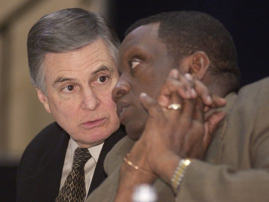 In this 2002 photo, Alexandria Mayor Ned Randolph (left) and Pineville Mayor Clarence Fields discuss transportation options. Randolph, who served as Alexandria mayor from 1986 to 2006, died Tuesday at the age of 74.