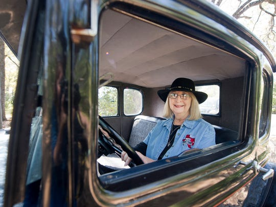 Sherry Hinnant sits behind the wheel of her 1931 Ford