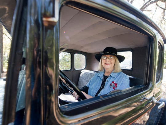 """Sherry Hinnant sits behind the wheel of her 1931 Ford Model A Coupe on Wednesday. Hinnant, who bought the car in 1964, named it """"Miss Ellie"""" in honor of her mother."""