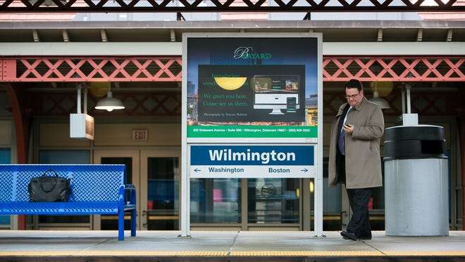 A man waits for his train on the Amtrak platform at the Joseph R. Biden Jr. Railroad Station in Wilmington.