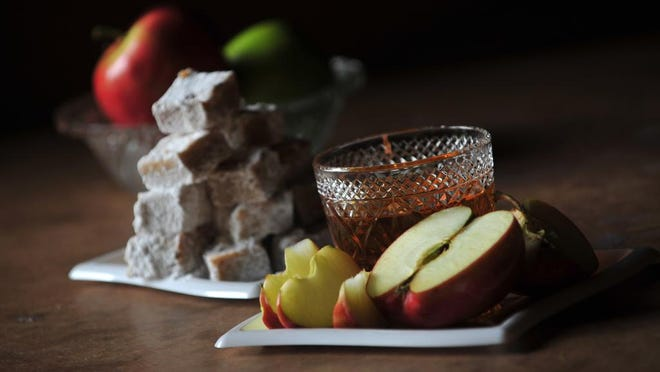 For Rosh Hashana: Honey Butter Squares made by Lynn Anne Cutler, education director for Temple Beth Am in Parsippany, and apple slices to dip into honey.