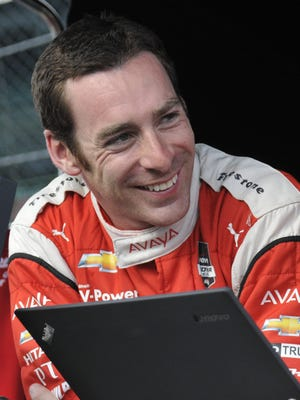 Simon Pagenaud is all smiles after setting the fastest practice lap on Fast Friday at the Indianapolis Motor Speedway on May, 15, 2015.