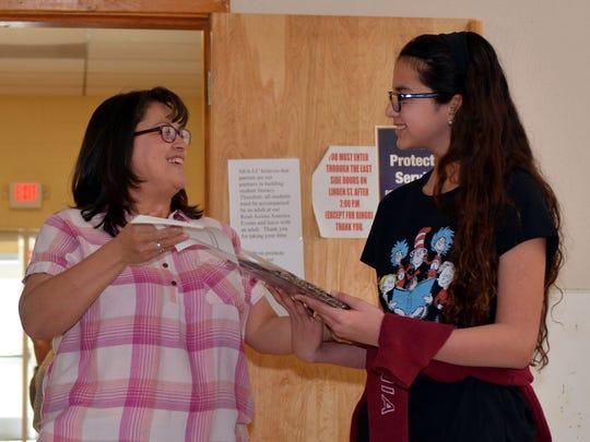 Delilah Moreles, left, from the NEA-LC chapter awards