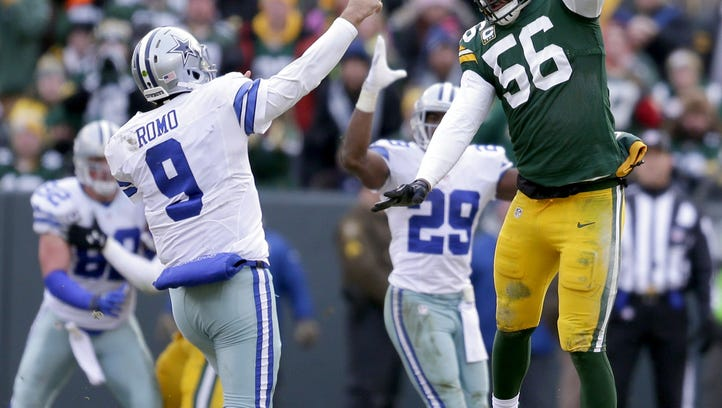 Gannett Wisconsin Media Linebacker Julius Peppers (56) forces a high throw from Cowboys quarterback Tony Romo during the NFC divisional playoff game Jan. 11 at Lambeau Field. Green Bay Packers linebacker Julius Peppers (56) forces a high throw from Tony Romo (9) against the Dallas Cowboys during an NFC divisional playoff  Sunday, January 11, 2015, at Lambeau Field in Green Bay, Wis.  Wm.Glasheen/P-C Media