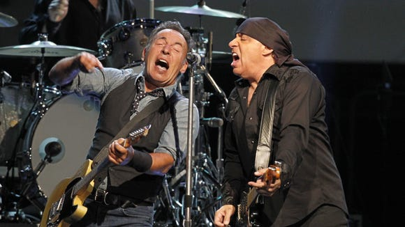 Bruce Springsteen, left, and guitarist Stevie Van Zandt perform to a sold out crowd at the Blue Cross Arena in Rochester Wednesday, Oct. 31, 2012. Springsteen's Rochester appearances routinely sell out quickly.