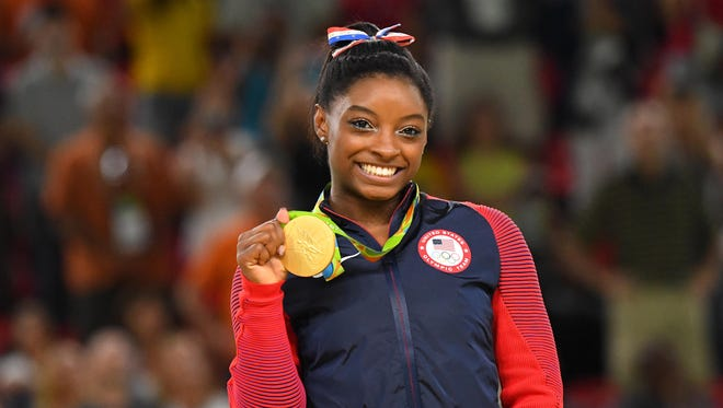 Simone Biles celebrates after winning a gold medal during to the women's floor exercise final in the Rio 2016 Summer Olympic Games at Rio Olympic Arena on Aug. 16.