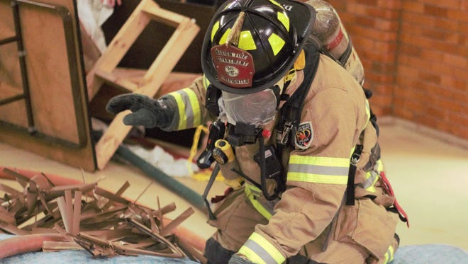 Firefighter Doug Kalb navigates through a training course at the Marion City Fire Department's main fire station Tuesday afternoon.