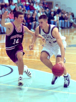 Former Lebanon Valley star Andy Panko drives to the basket during a game in his 1998 junior season. Panko, now 38, continues to play professionally overseas and owns a basketball training facility in Annville.