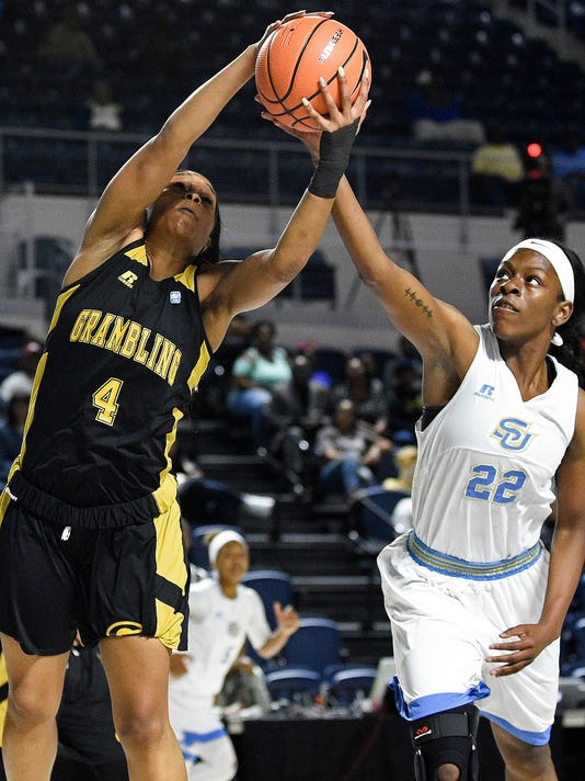 Grambling State guard Monisha Neal (4) and Southern forward Briana Green (22) vie for a rebound during the first half of an NCAA college basketball game in the championship of the Southwestern Athletic Conference, Saturday, March 10, 2018, in Houston. (AP Photo/Eric Christian Smith)