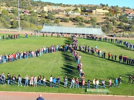 La Plata students made a peace sign which was part