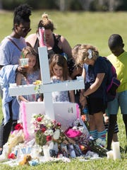 Feb 16, 2018; Parkland, FL, USA; Mourners gather at