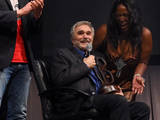 Actor Burt Reynolds jokes with the audience Friday,