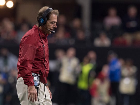 Alabama head coach Nick Saban walks to his team during