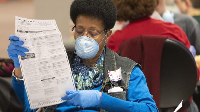City of Milwaukee Election Commission workers process absentee ballots in Wisconsin's presidential primary.