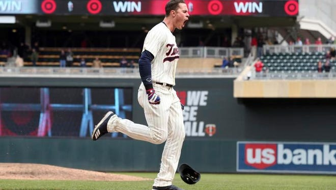 Minnesota Twins' Max Kepler celebrates as he heads home after hitting the game-winning home run off of Houston Astros pitcher Brad Peacock in the ninth inning of a baseball game Wednesday, April 11, 2018, in Minneapolis.