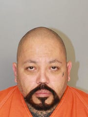 Booking mug of musician A.B. Quintanilla. He was arrested