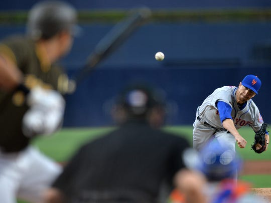 Apr 27, 2018; San Diego, CA, USA; New York Mets starting pitcher Jacob deGrom (48) pitches during the first inning against the San Diego Padres at Petco Park.