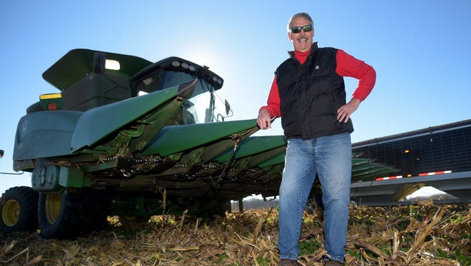 Navy veteran Mike Nocton harvests a field of corn Thursday, Nov. 10, 2016 south of Richmond. Nocton is in a national contest through a farming publication for farmers who served in the military.