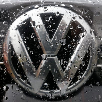 Volkswagen to shed 30,000 jobs, cutting costs after emissions scandal