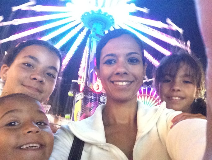 "Here's a selfie of Robyn Bryson and her three daughters – Jade, Kyla and Halle – enjoying the Boone County Fair. Kyla won the 1-year-old baby show back in 2005. She's still proud of her blue ribbon. Send your ""Fair Selfie"" to ndaly@communitypress.com. The fair continues through Saturday."