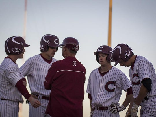 Chiles head coach Dick Steed advises his players during their game versus Lincoln on Friday at Chiles High School. The Timberwolves won 4-0.