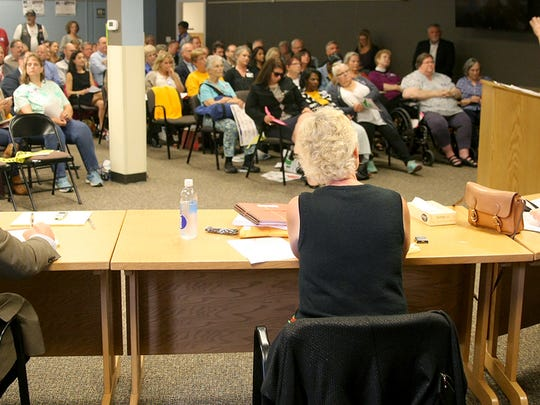State Department of Health staff members listen to public testimony at a hearing regarding the move of Harrison Medical Center from Bremerton to Silverdale on Friday.