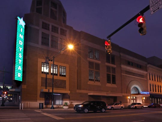 The lighted sign on the IndyStar office building is tested on Sept. 11, 2014. The sign's color can be changed with a remote control. The Star moved from its 107-year-old building to the new offices, in former Nordstrom retail space in the mall, the week of Sept. 29, 2014.