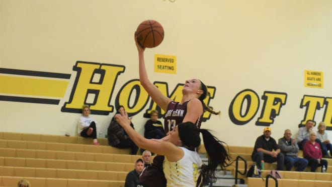 John Glenn's Madison Hunter goes up for a layup against a Tri-Valley defender. Hunter signed her letter of intent to play for Malone on Friday.