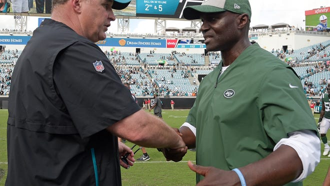 Jacksonville Jaguars head coach Doug Marrone, left, and New York Jets head coach Todd Bowles shake hands after an NFL football game, Sunday, Sept. 30, 2018, in Jacksonville, Fla. (AP Photo/Phelan M. Ebenhack)